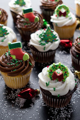 Christmas cupcakes with decorations and sprinkles