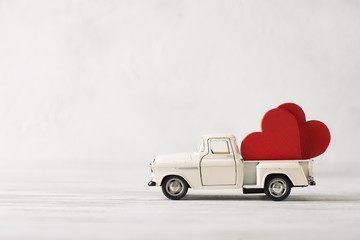 Valentines Day Theme Concept Couple Hearts In Toy Car On Grey Background