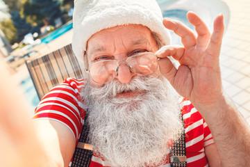 Santa Claus near the pool holiday vacation concept