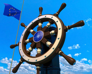 Steering wheel and European Union flag on sky background