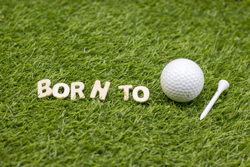 Born to be golfer on green grass