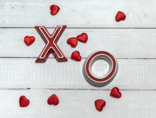Hugs and kisses for Valentines Day on wooden background
