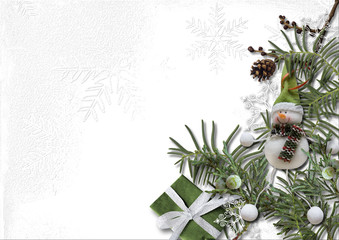 Christmas and New Year decorations with coniferous branches on a white background. Greeting card