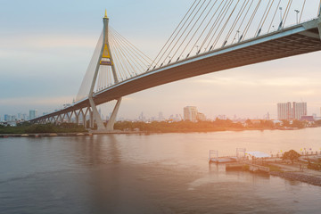 Suspension bridge cross Bangkok river landmark, cityscape background