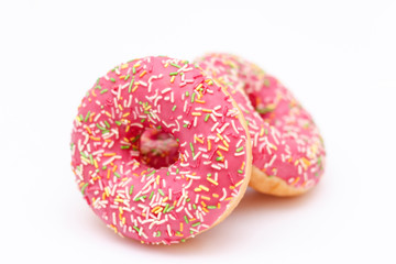 Pink glazed donuts on a white background