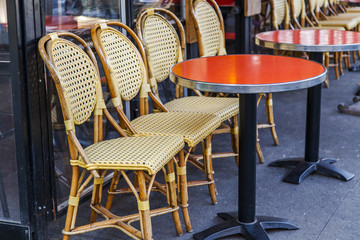 PARIS, FRANCE, on October 30, 2017. Empty little tables of traditional cafe stand on the sidewalk and expect visitors.