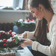 Beautiful Woman Making Christmas Decorations at Home