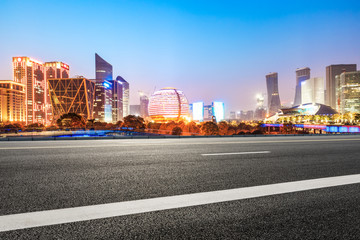 Asphalt highway and modern city buildings in hangzhou qianjiang new city at night