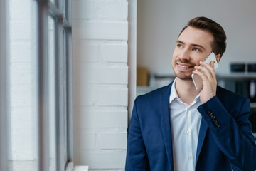 Young businessman talking on a mobile phone