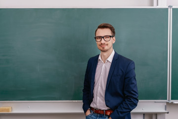 Confident male teacher wearing glasses