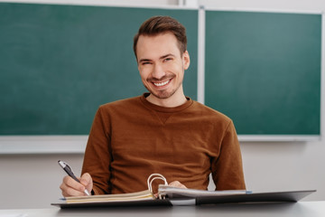 Happy male student with a confident smile