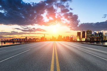 Asphalt highway and modern city buildings in hangzhou qianjiang new city at sunset