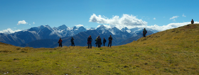 Group of tourist with Hohe Tauern on backround, Austria