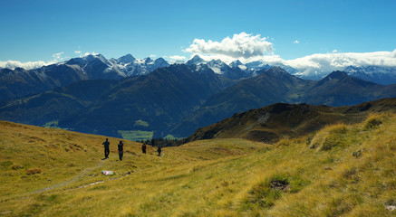 Tourist on the mountain way with Hohe Tauern on backround, Austria
