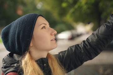 portrait of teen girl looking on the map in the city in autumn