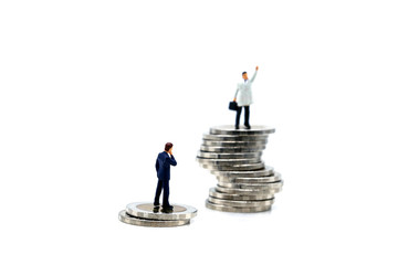 Miniature people : businessman standing on top of coin on white background