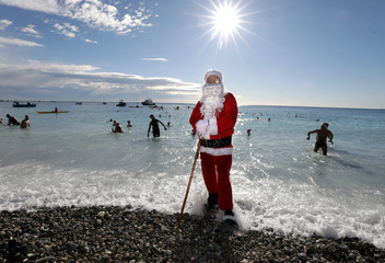 A man dressed as Santa Claus takes part in the traditional Christmas season swim in Nice