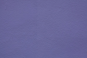 Purple painted stucco wall. Background texture