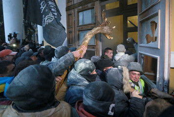 Supporters of former Georgian President and Ukrainian opposition figure Mikheil Saakashvili break into the building of the International Art Centre in Kiev