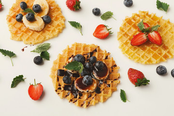 Waffles with fruits, breakfast background