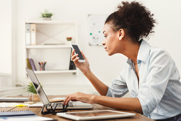 Business woman looking at smartphone