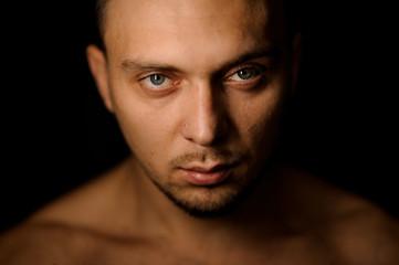 Horizontal studio portrait of attractive muscular man