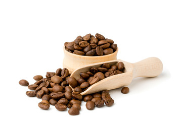 Coffee beans in a wooden bowl and shovel