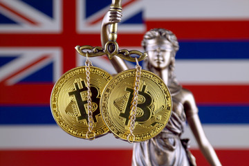 Symbol of law and justice, physical version of Bitcoin and Hawaii Flag. Prohibition of cryptocurrencies, regulations, restrictions or security, protection, privacy.