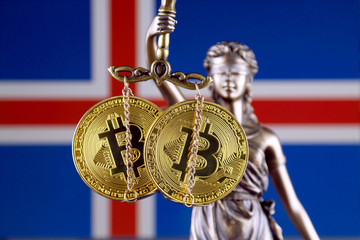 Symbol of law and justice, physical version of Bitcoin and Iceland Flag. Prohibition of cryptocurrencies, regulations, restrictions or security, protection, privacy.