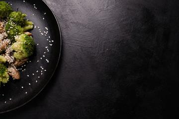 spring salad. vegan food on dark background. proper nutrition restaurant. free space concept.