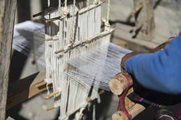 woman weaver in Nepal, the city of Manang. Mustang, Himalayas, December 2017