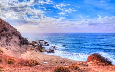 Beautiful landscape of Tejita beach in summer season, vith people enjoying the vacation on Canary island, Spain