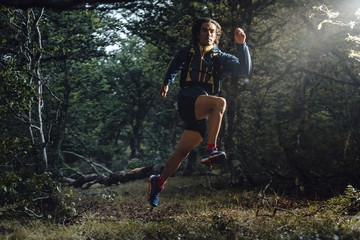Front view of a ultra trail runer running on a forest close to Collado Jermoso, Leon, Spain