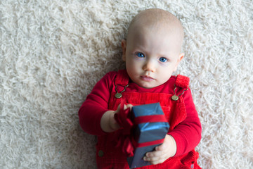 Cute Baby with christmas presents.Overhead view