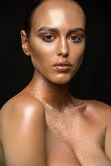 Gorgeous brunette with gold skin isolated shot