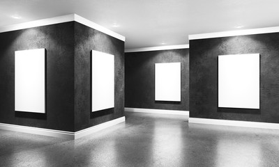 Modern concrete gallery room with directional spotlight and frames. Product artwork exhibition mock up. White isolated art frames. 3d rendering illustration of interior with black plaster walls in per
