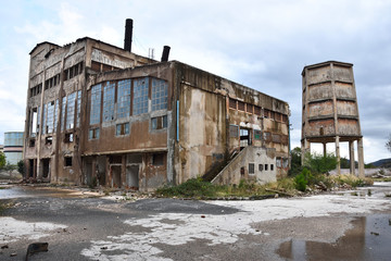 Abandoned industrial zone in Chroatia under overcast weather.