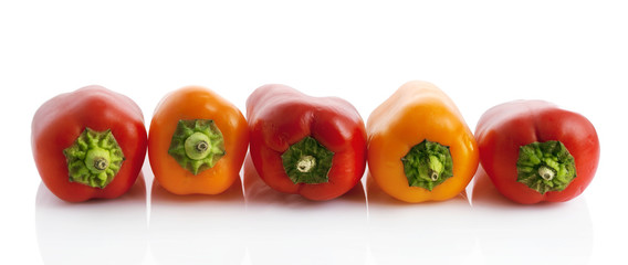 Panorama of peppers isolated on white