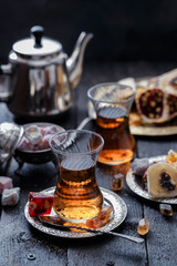 Tea in traditional turkish glasses with oriental delights and sweets