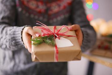 Hands of woman holding christmas gift box. Christmas