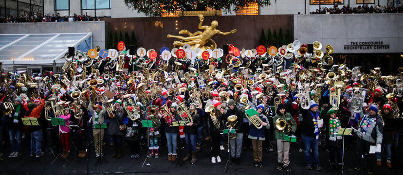 Tuba Players perform Christmas Carols at 44th Annual Merry Tuba Christmas at Rockefeller Center in the Manhattan borough of New York