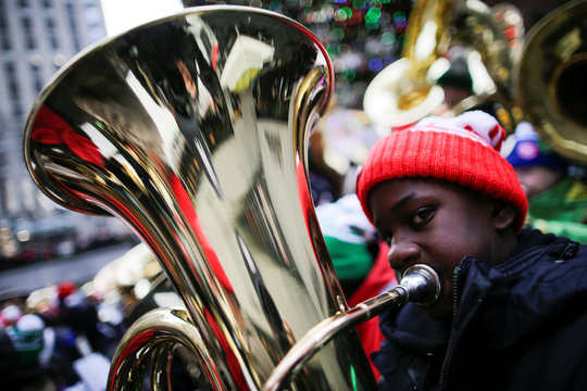 A tuba player performs Christmas carols during the 44th Annual Merry Tuba Christmas at Rockefeller Center in the Manhattan borough of New York