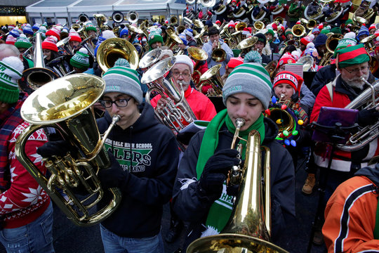 Tuba players perform Christmas carols during the 44th Annual Merry Tuba Christmas at Rockefeller Center in the Manhattan borough of New York