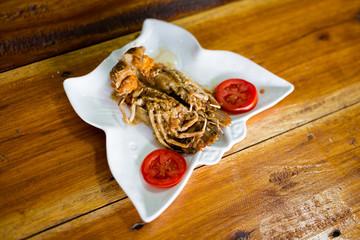 Flathead lobster fried with garlic