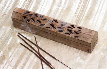 incense box with sticks and smoke