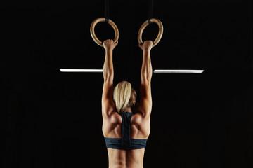 Female fitness athlete exercising