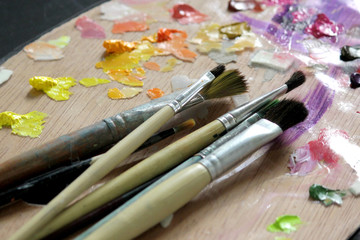 artists paint brushes on wooden palette