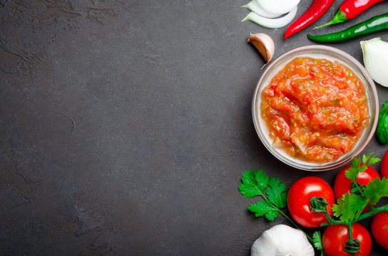 Traditional mexican homemade salsa sauce with ingredients, tomat