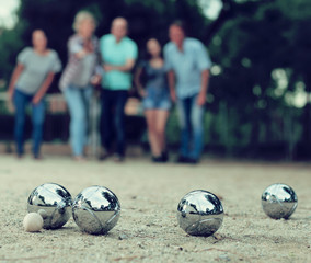 Image of people playing petanque on sand