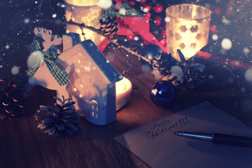 new year hand write on table with pine cone candle